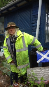 This is Sandy Masson. She is pointing to a flag of Scotland. Fair to say she is pro - independence. Something they will be voting on September 2014.