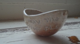 "A shot glass Marlene made and gave to me that says -"" May the work that you have be the play that you have"""